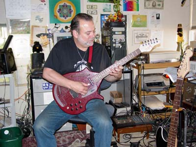 Eric Van der Wyk plays the electric Sitar